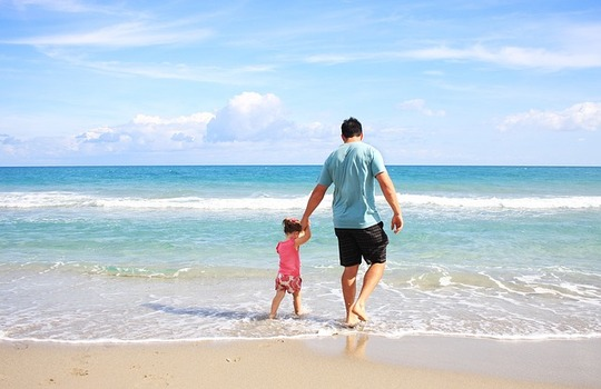 Man with child on beach